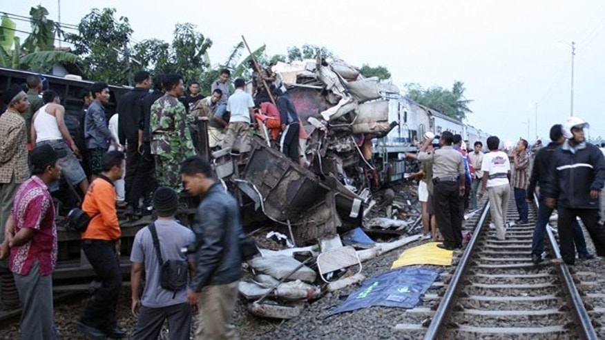 Oct. 2: Rescuers search for victims of a train crash near a station in Petarukan, Indonesia. The early morning train crash killed at least 36 and injured dozens, many of critically, officials and witnesses said.