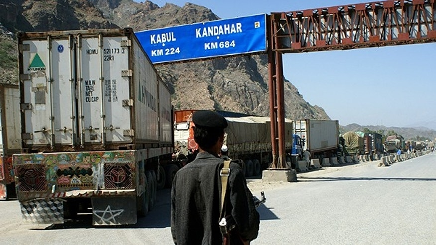 Oct. 1: A Pakistani border guard stands near Afghanistan-bound NATO trucks parked on the roadside in Pakistani tribal area of Khyber. Pakistan closed the supply route after a coalition helicopter attack mistakenly killed three Pakistani soldiers at a border post, raising tensions in a vital relationship for both Islamabad and Washington.