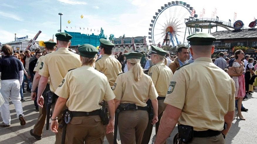 Oct. 3: Police officers patrol through the crowd at the Oktoberfest beer festival in Munich, southern Germany.