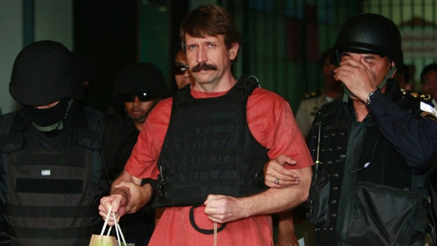 Oct. 4, 2010: With tight security and the flak jacket on, Viktor Bout, center, a suspected Russian arms dealer, leaves the criminal court in Bangkok, Thailand.