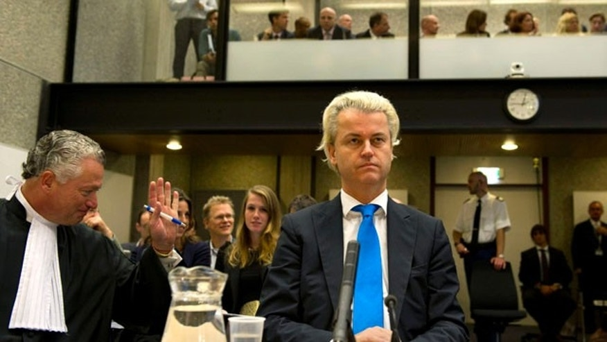 Oct. 4, 2010: Dutch anti-Islam politician Geert Wilders, centre, and his lawyer, Bram Moszkowicz, left, await the start of his trial inside the courtroom in Amsterdam, Netherlands.