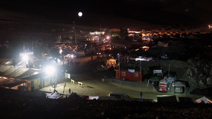 Oct. 8: An illuminated balloon hovers over the camp were relatives of a trapped miners wait for news of the rescue effort near the San Jose mine in Copiapo, Chile.