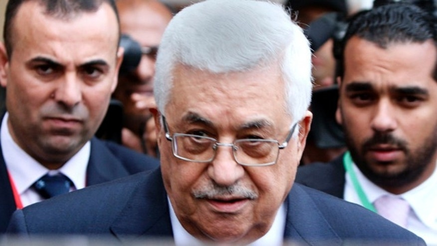 Oct. 9: Palestinian President Mahmoud Abbas leaves the first session of the Arab summit in Sirte, Libya.