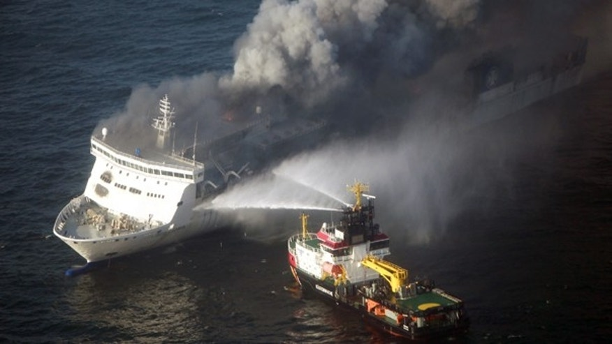 Oct. 9: A firefighting vessel tries to extinguish a fire on the car ferry Lisco Gloria in the Baltic Sea.  The Lithuanian-flagged ferry had more than 200 people on board and was traveling from the German port of Kiel to Klaipeda, Lithuania.