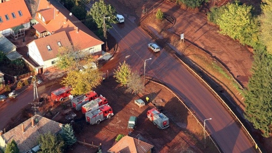 Oct. 10: An aerial view shows a street of the red mud-hit town Devecser 164 kms southwest of Budapest, Hungary.