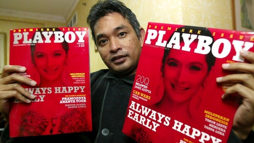 April 6, 2006: Playboy Indonesia editor-in-chief Erwin Arnada shows copies of the first edition of the magazine in Jakarta, Indonesia.