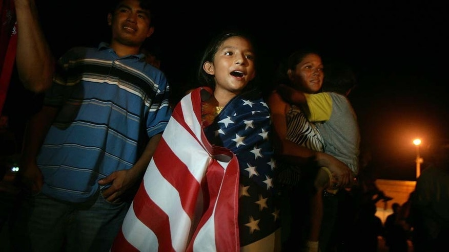 AVON PARK, FL - JULY 24:   Zury Ruiz, 9, wears an American flag around her shoulders after hearing the news that the Avon Park city council voted against a proposal that would have cracked down on illegal immigration July 24, 2006 in Avon Park, Florida. The ordinance was defeated 3 votes to 2. Macklin had proposed:  fining landlords who rent to illegal immigrants; taking away business permits from companies that knowingly employs illegals; and declaring English the official language within Avon Park.  (Photo by Joe Raedle/Getty Images)
