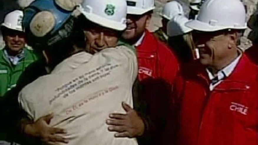 In this screen grab taken from video, Bolivian President Evo Morales, third from left, embraces Jorge Galeguillos, the eleventh miner to be rescued from the San Jose Mine near Copiapo, Chile on Wednesday, Oct. 13, 2010.