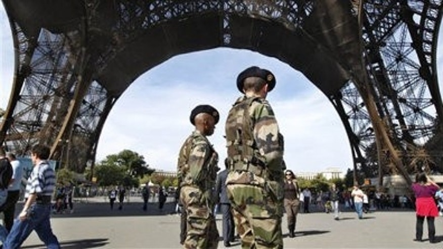 French soldiers patrol under the Eiffel Tower in Paris Oct. 3.