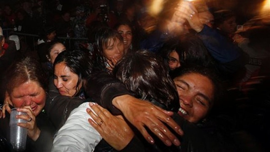 Relatives and friends of 33 freed miners celebrate the end of the successful rescue operation at the camp outside the San Jose mine near Copiapo, Chile, Wednesday Oct. 13, 2010.
