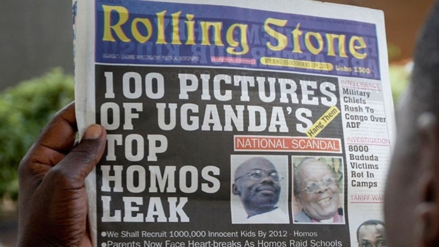 "A Ugandan man reads the headline of the Ugandan newspaper ""Rolling Stone"" in Kampala, Uganda. Tuesday, Oct. 19, 2010, in which the papers reveals the identity of allegedly gay members of Ugandan society and calls for public punishment against those individuals."