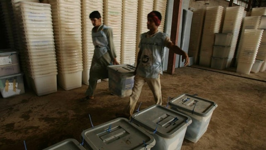Sept. 19: Afghan election workers stack ballot boxes at Afghanistan's Independent Election Commission in Herat. More than 1 million ballots may be thrown out due to suspicions of fraud.