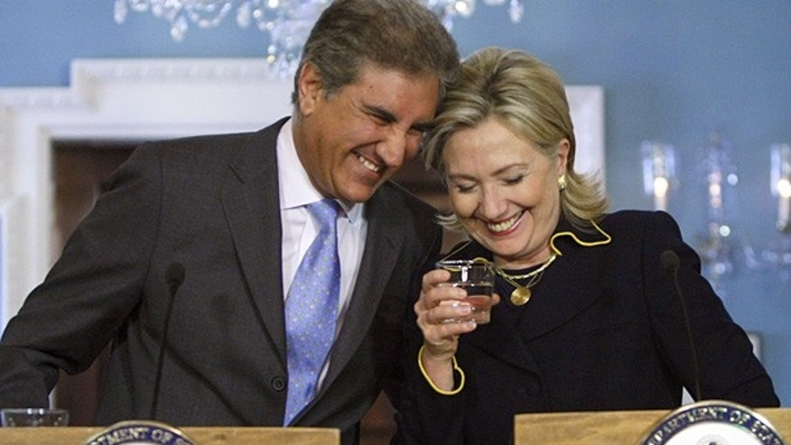 Mar. 24: Pakistan Foreign Minister Shah Mehmood Qureshi shares a laugh with Secretary of State Hillary Rodham Clinton at the State Department in Washington.
