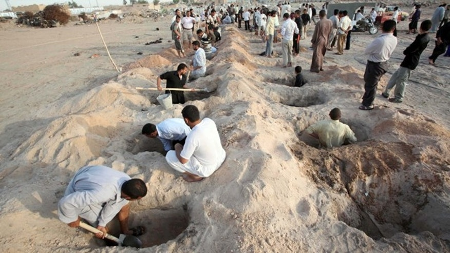 April 23, 2010: gravediggers set to work as victims of a wave of bombings arrive for burial in the Shiite holy city of Najaf, 100 miles south of Baghdad, Iraq.