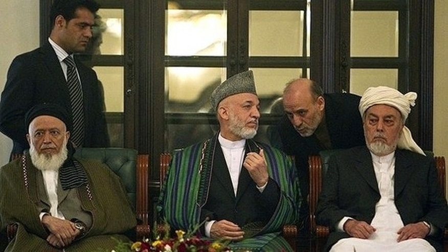 Oct. 7: Afghan President Hamid Karzai speaks to his staff during the inauguration ceremony for the High Peace Council, appointed to broker peace with the insurgents in Afghanistan, at the presidential palace in Kabul.