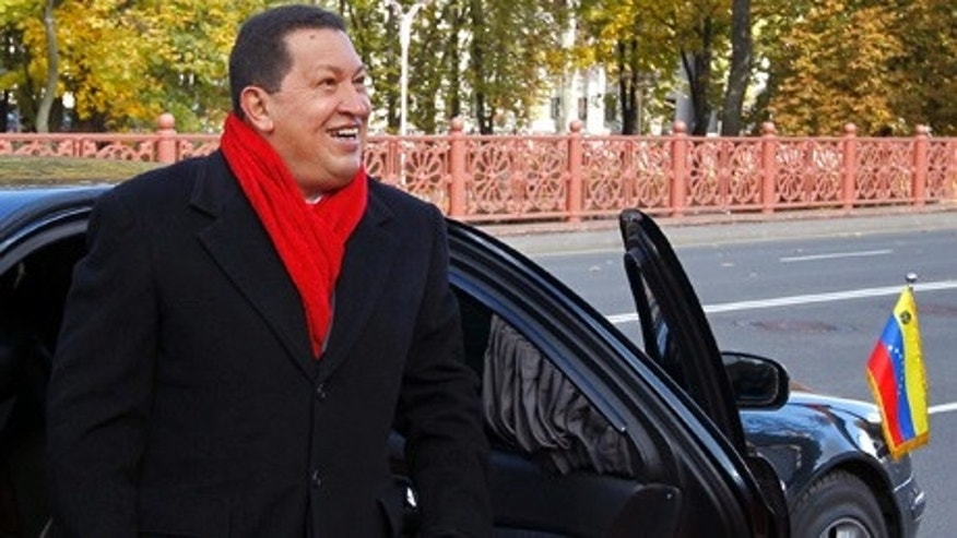 Venezuelan President Hugo Chavez arrives to meet his Belarusian counterpart in Minsk, Belarus Saturday Oct. 16, 2010. Chavez will meet with his Belarusian counterpart Alexander Lukashenko in Minks on Saturday to discuss trade and economic relations between the two countries. Chavez flew to the Belarusian capital from Moscow as part of his international tour, which also includes Ukraine and Iran.   (AP Photo//Vasily Fedosenko, Pool)