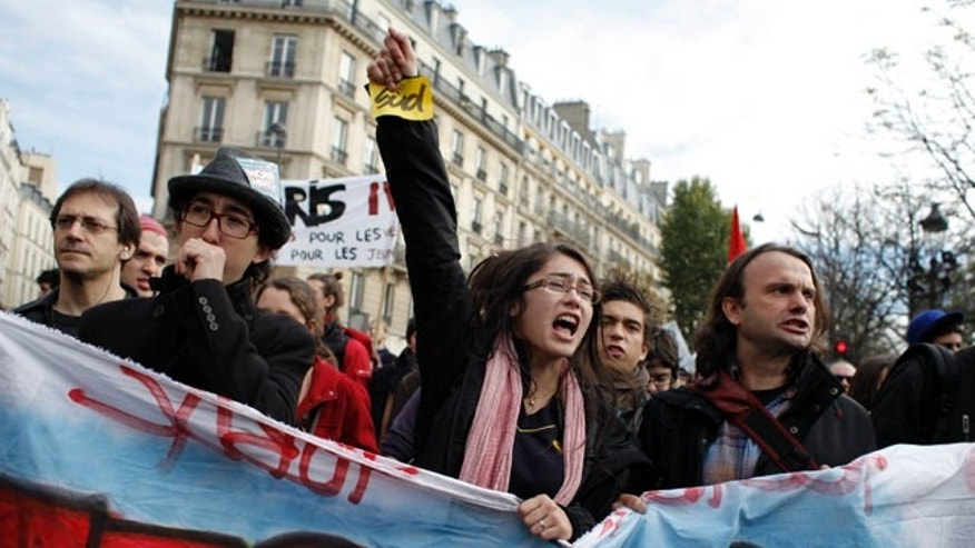 """Oct. 26: Students shout slogans during a demonstration in front of the Senate in Paris. Nationwide protests and strikes over government moves to change the retirement age from 60 to 62 have disrupted French life and the country's economy for weeks, but the finance minister has declared that the slowing protest movement has reached a """"turning point."""""""