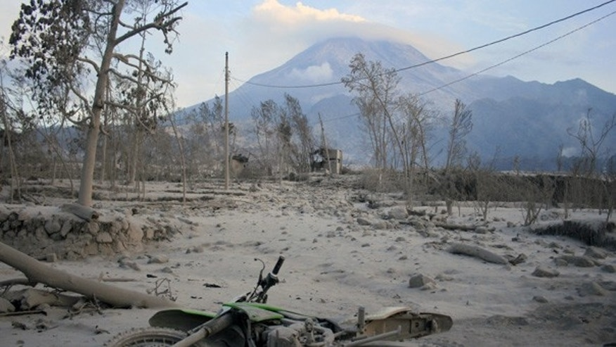 Oct. 27: A motorcycle lies covered in volcanic ash in a village hit by pyroclastic flows from Mt. Merapi in Kaliadem, Indonesia.