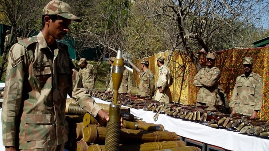 Oct. 26: Pakistan army soldiers stand near confiscated arms and ammunition during operations against militants in Kalaya in Pakistan's tribal area of Orakzai near the Afghanistan border.