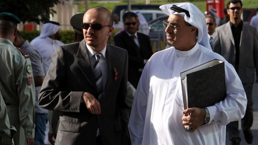 Oct. 28, 2010: Bahraini lawyer Mohamed al-Tajer, right in white, walks away from the Manama, Bahrain courthouse.