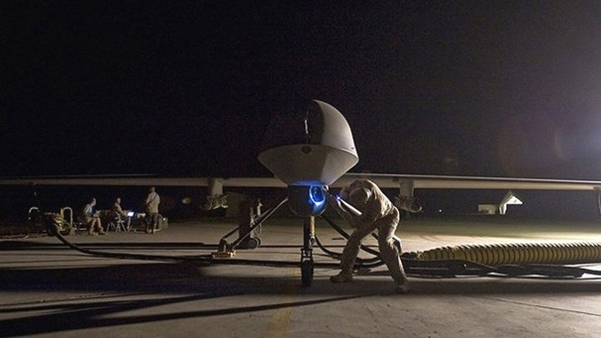 A pre-flight inspection of an MQ-1B Predator unmanned drone aircraft.