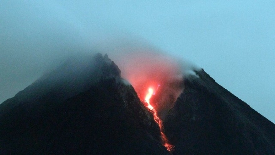 Lava flows from the crater of Mount Merapi as seen from Cangkringan, Yogyakarta, Indonesia, early Friday, Oct. 29, 2010.