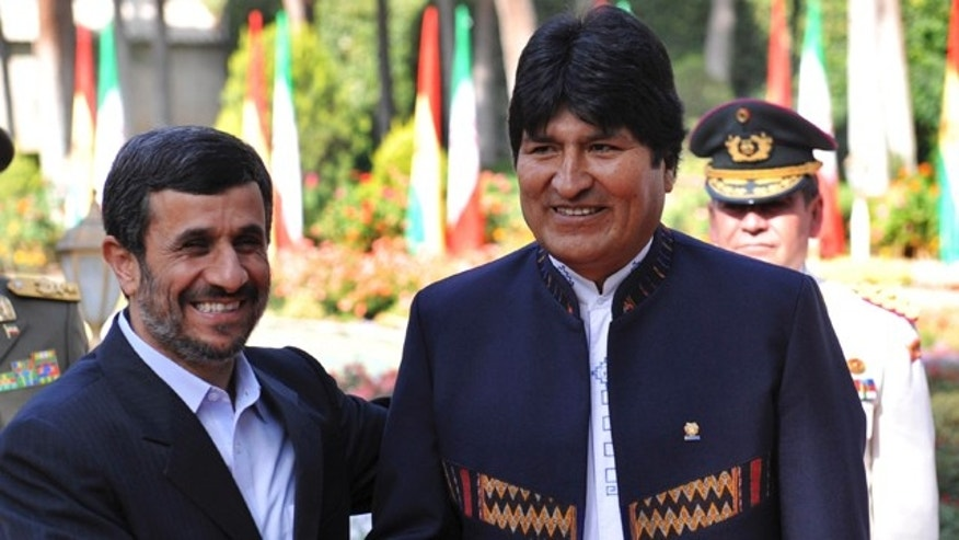Oct. 26:  Iranian President Mahmoud Ahmadinejad, left, shakes hands with his Bolivian counterpart Evo Morales, during an official welcoming ceremony for him, in Tehran, Iran. (AP/ISNA)