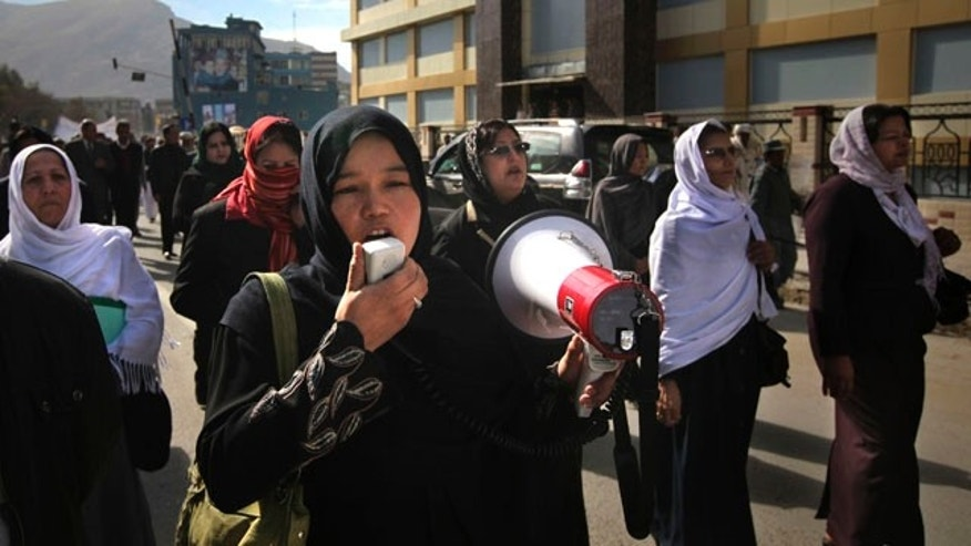 Nov. 3: A former legislator shouts slogans as she leads a protest march against September's parliamentary poll in Kabul, Afghanistan.