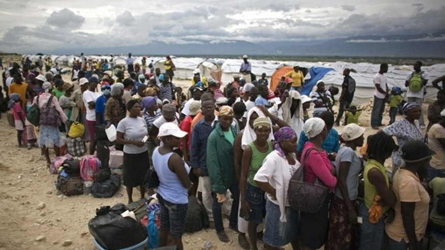 Nov. 4: Haitians wait to be evacuated from a tent refugee camp before the arrival of Tomas.