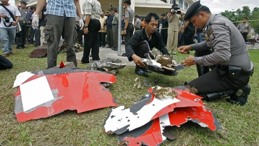 Nov. 4: Local police inspect debris from a Qantas jetliner that were found in Batam, Indonesia.