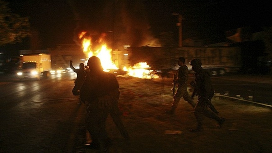 Nov. 5: Policemen arrive at the scene as a truck burns in the city of Morelia, Mexico.