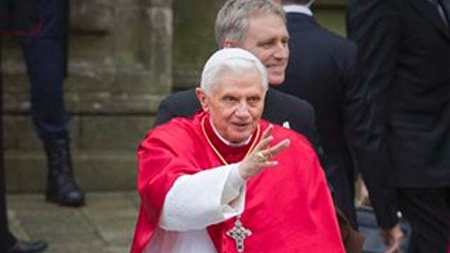 Pope Benedict XVI waves outside the Cathedral in Santiago de Compostela, northern Spain, on Saturday, Nov. 6, 2010. The Pope visits the pilgrimage city of Santiago de Compostela to celebrate its Holy year as part of a two-day trip to Spain. (AP Photo/Lalo R. Villar)
