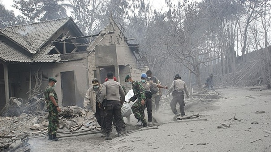 Nov. 5: Rescuers search for victims of Mount Merapi eruption in Argomulyo, Yogyakarta, Indonesia.