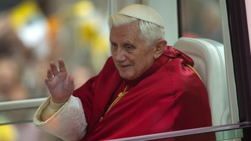 Nov. 7: Pope Benedict XVI waves from his pope-mobile on his way to the Sagrada familia church in Barcelona , Spain.
