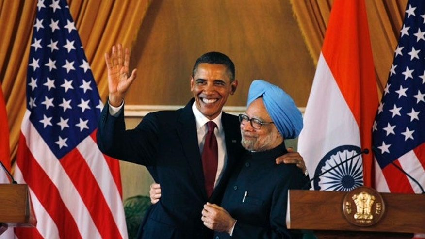 Nov. 8: U.S. President Barack Obama, left, and Indian Prime Minister Manmohan Singh, embrace following a joint statement and press conference at Hyderabad House in New Delhi, India.