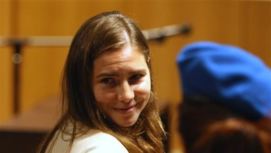 Nov. 20, 2009: Amanda Knox arrives at Perugia's court in Italy. She is currently serving a 26-year prison term following her conviction for the murder of British student Meredith Kercher.  (AP)