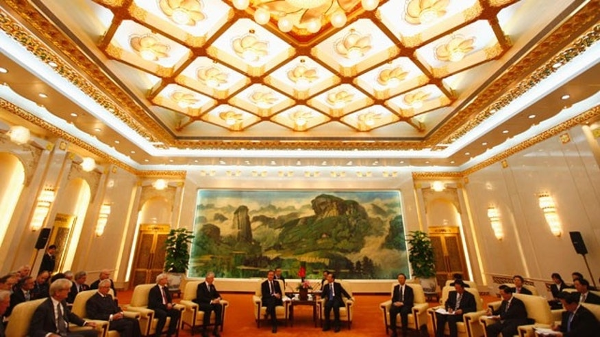 Nov. 9: Britain's Prime Minister David Cameron, center left, and China's Premier Wen Jiabao, center right, attend a meeting with British industrial and commercial business delegates at the Great Hall of the People in Beijing, China.