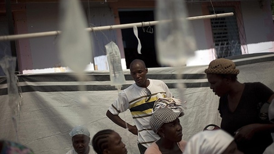 Nov. 8: Patients suffering cholera symptoms receive treatment at the St. Nicholas hospital in Saint Marc, Haiti.