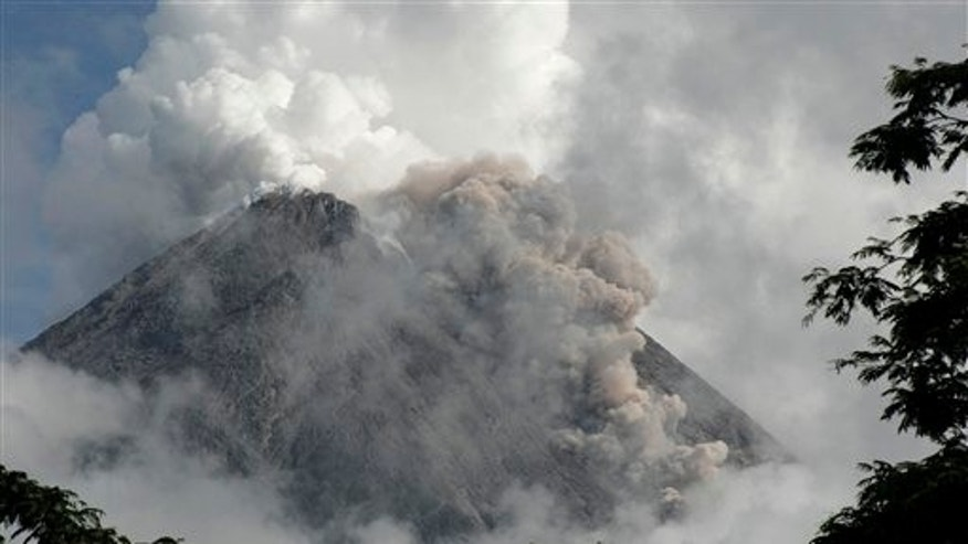 Nov 2, 2010: Mount Merapi spews volcanic material as it erupts as seen from Pangukrejo, Yogyakarta, Indonesia. Indonesia's most dangerous volcano forced international airlines to cancel flights to nearby airports Tuesday, as fiery lava lit the rumbling mountain's cauldron and plumes of smoke blackened the sky.