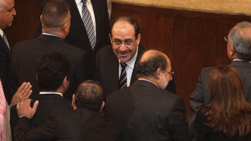Nov. 11: Iraqi Prime Minister Nouri al-Malik, center, shakes hands with a lawmaker during a parliament session in Baghdad, Iraq.