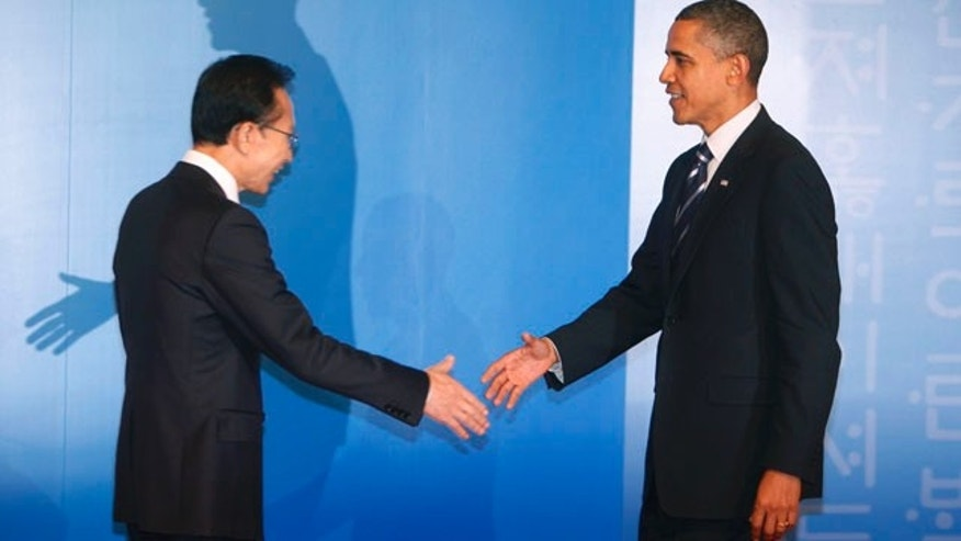 Nov. 11: South Korean President Lee Myung-bak, left, welcomes US President Barack Obama for a reception at the G-20 summit in Seoul, South Korea.