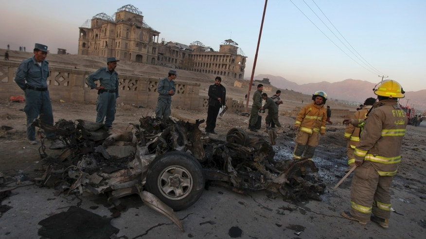 Nov. 12, 2010: Afghan police officers inspect the remains of a vehicle used by a suicide bomber at the site on an explosion on the outskirts of Kabul, Afghanistan.