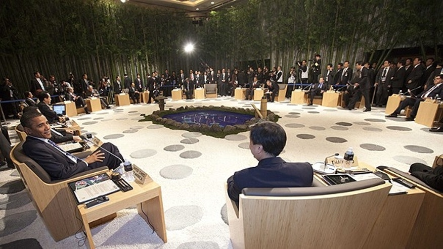 Nov. 13: President Obama, left, talks with Thai Prime Minister Abhisit Vejjajiva as they attend the Leaders Retreat during the APEC summit in Yokohama, near Tokyo.