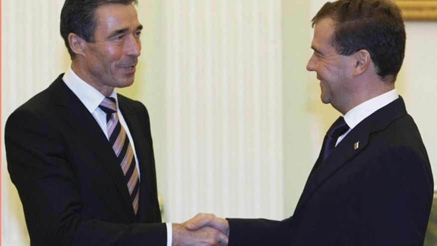 Nov. 3, 2010: Russian President Dmitry Medvedev, right, shakes hands with NATO Chief Anders Fogh Rasmussen during their meeting in the Kremlin in Moscow, Russia.