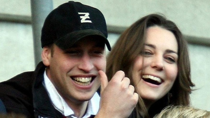 Britain's Prince William and Kate Middleton, watch the England against Italy Six Nations rugby match at Twickenham stadium in London, in this Saturday Feb. 10, 2007 file photo. According to an announcement by Clarence House in London, Tuesday Nov. 16, 2010, the couple are to wed in 2011, Further details about the wedding day will be announced in due course.