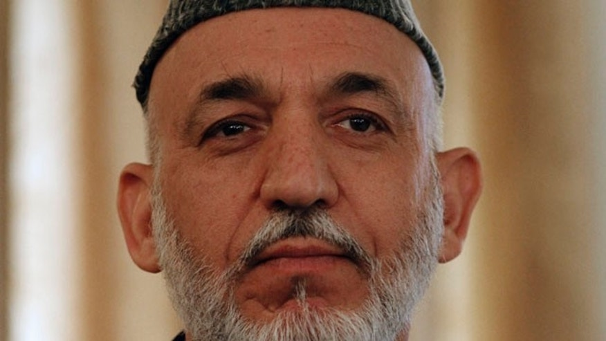 Afghan President Hamid Karzai (pictured) met with Gen. David Petraeus in Kabul for the first time since Karzai called for a drawdown of NATO military activities.