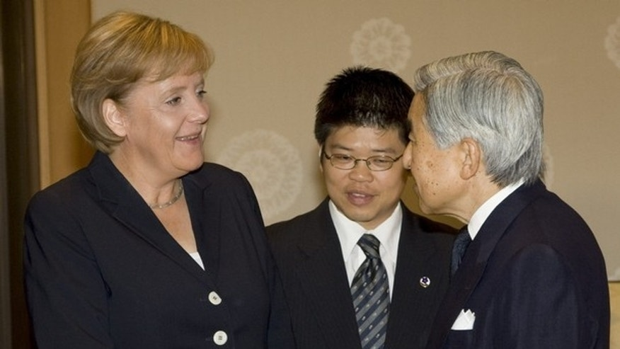 Aug. 29, 2007: Japan's Emperor Akihito greets German Chancellor Angela Merkel during their meeting in Tokyo (Reuters).