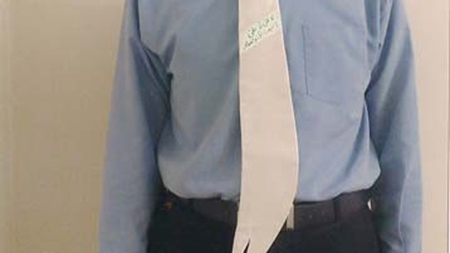 The necktie, designed by Hemat Komeili, is decorated with quotes by the Prophet Muhammad and is shaped like the sword of Shiite Imam Ali, Mumammad's cousin and brother-in-law, who is considered a holy figure in Iran, YNetNews.com reports.