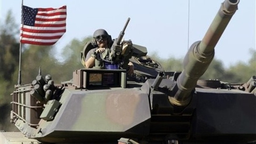 Sept. 8: An Abrams tank is seen in testing in Aberdeen, Md.