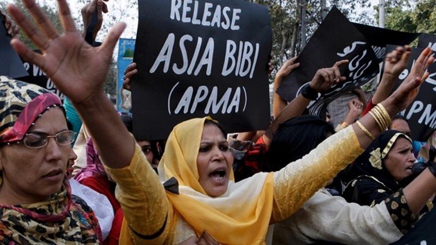 Supporters of All Pakistan Minorities Alliance chant slogans during a rally against blasphemy laws and demanding the release of Asia Bibi.  (AP)